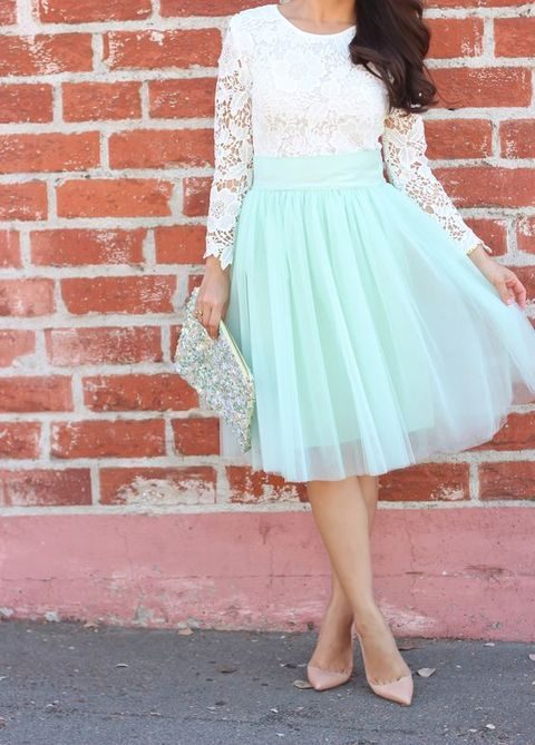 mint midi skirt and a long sleeve white shirt and nude heels