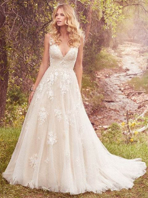 romantic ball gown with a deep V-neckline and lace appliques