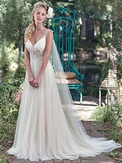 tulle wedding dress with an embellished bodice and straps