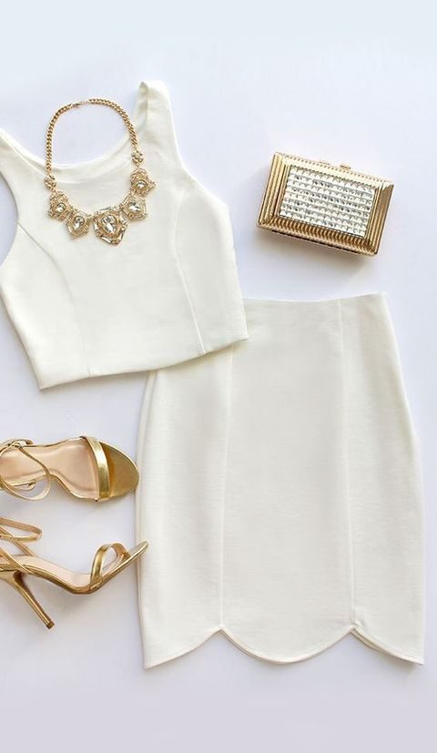 two piece ivory dress with a scallop edge skirt and metallic accessories