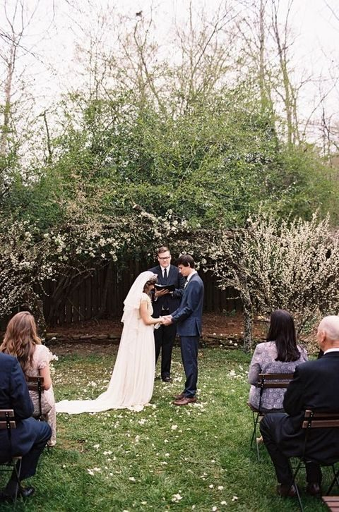 use spring blooms to advantage covering your ceremony arch with them