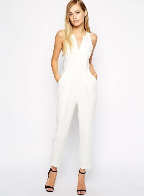 white jumpsuit without sleeves and black heels