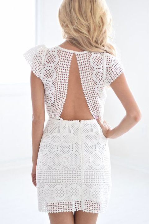 white lace dress with an open back