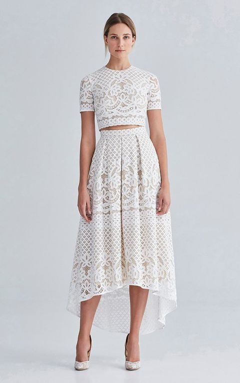 white lace midi high low skirt and a crop top with short sleeves