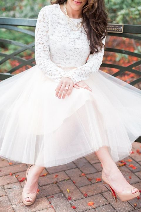 white long-sleeve lace top, a white tutu and nude heels