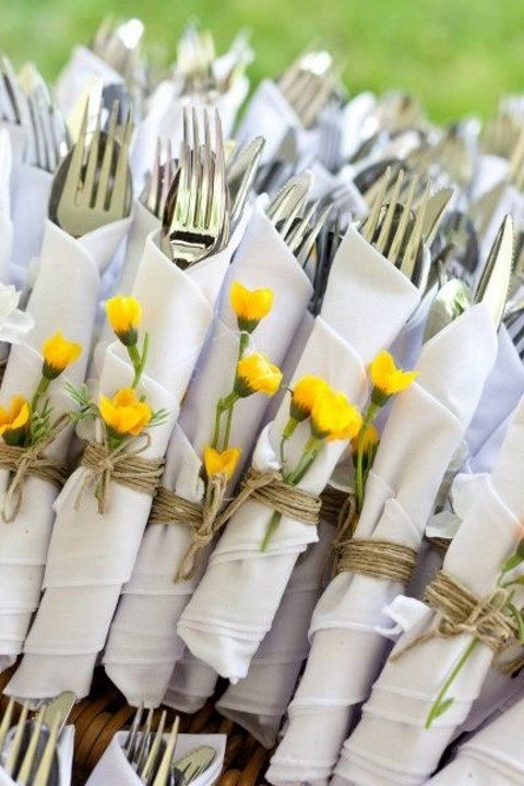 wrap the cutlery with napkins and fresh flowers