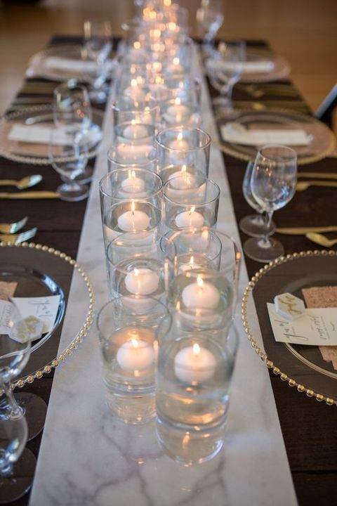 Carrara marble table runner with floating candles