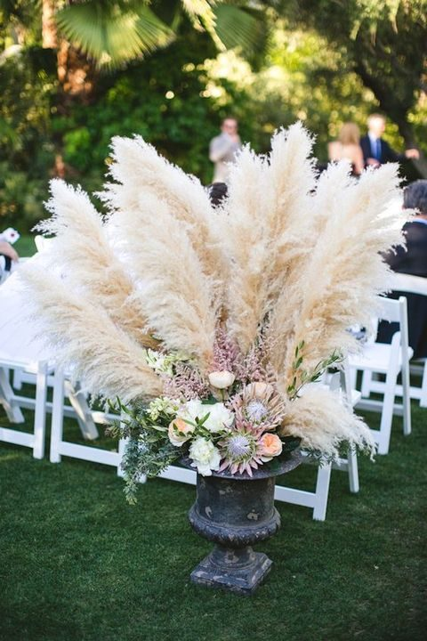 an urn with pampas, proteas and some flowers