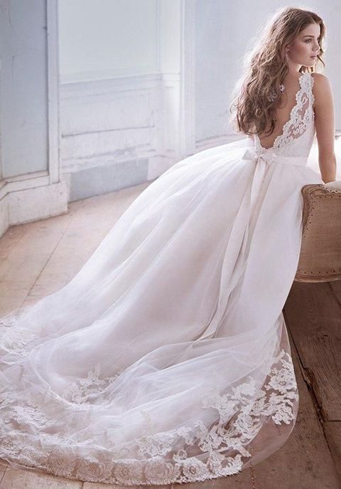 backless ballgown with a flowy skirt and a bow on the back