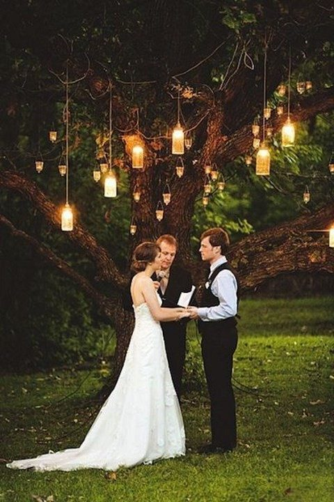 candle and light lanterns for the ceremony spot with a large tree