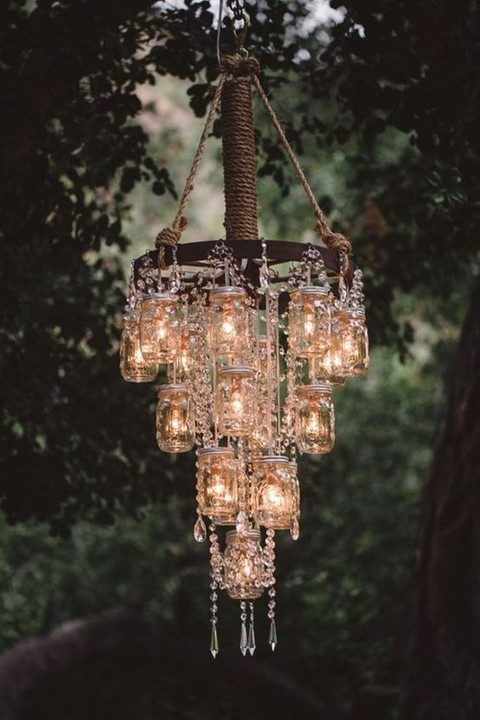 chandelier made of mason jar lights is a cool idea for a vintage or industrial wedding