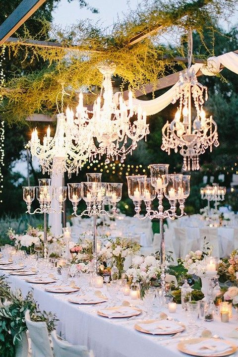 chic chandeliers and lots of candles on the tables
