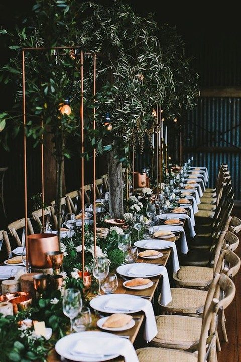 copper and greenery reception decor for an industrial garden wedding