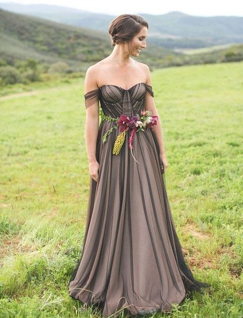 dark wedding gown with a moody floral wedding belt