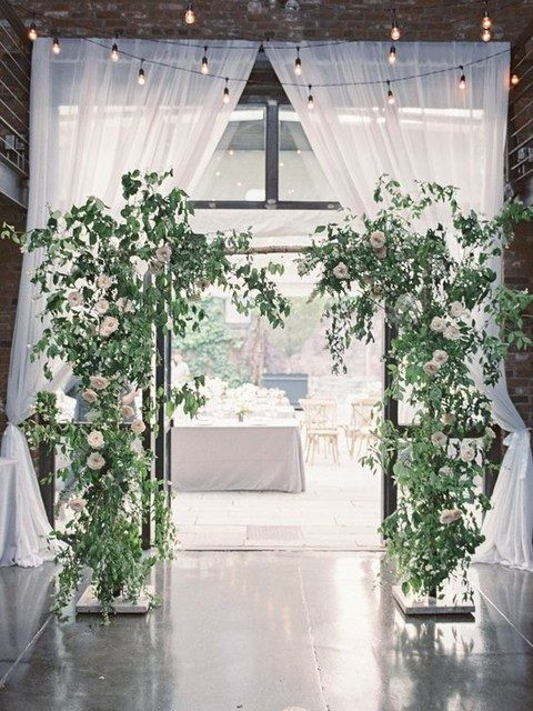 greenery and white flower wedding arch for a light garden feel