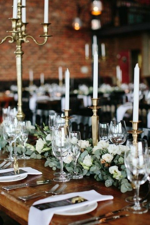 greenery, white roses and gilded candle sticks for reception tables