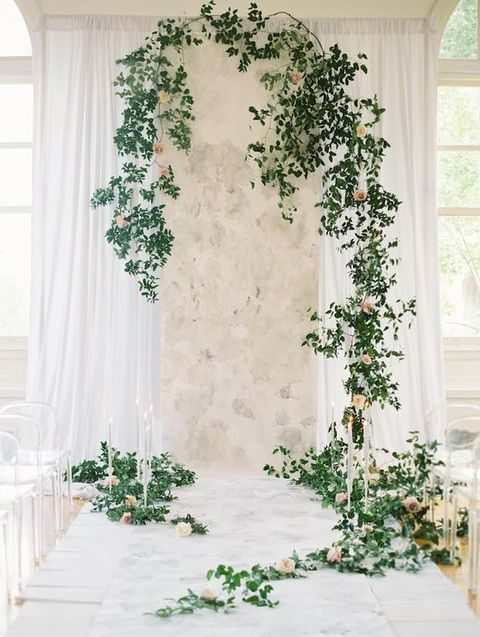 grey marble, lots of foliage and candles create a cool backdrop