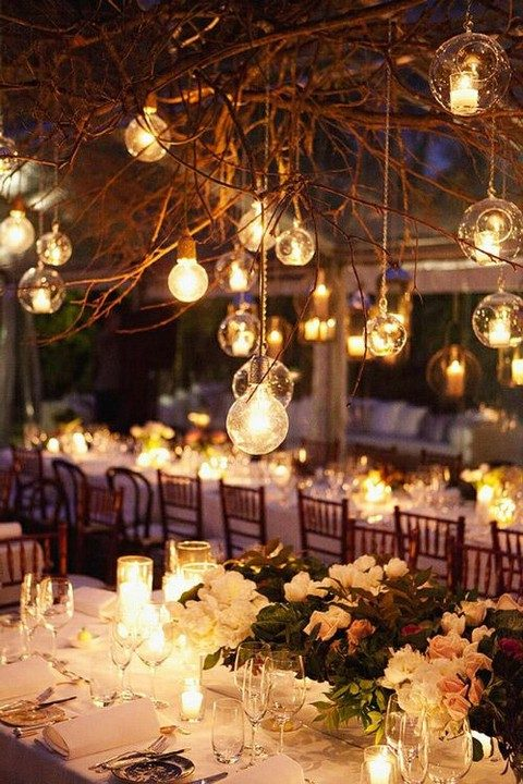 hanging bulbs and candle holders over the reception