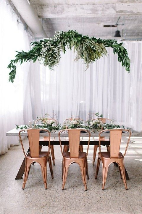 hanging greenery chandelier and a table runner
