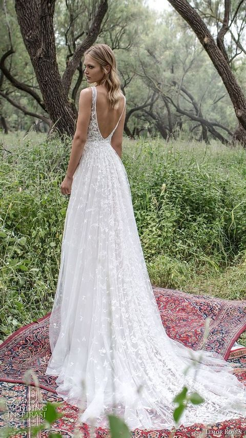 lace embellished A-line wedding dress with a small train