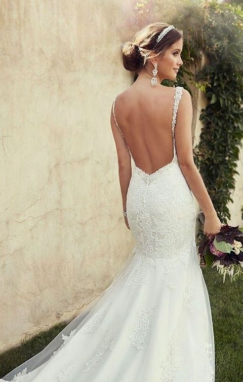 lace mermaid wedding gown with a small train and spaghetti straps