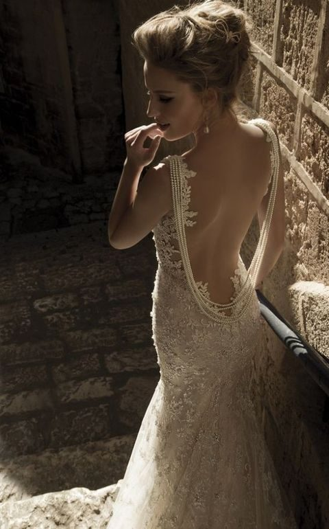 lace sheath wedding dress with a pearl back necklace