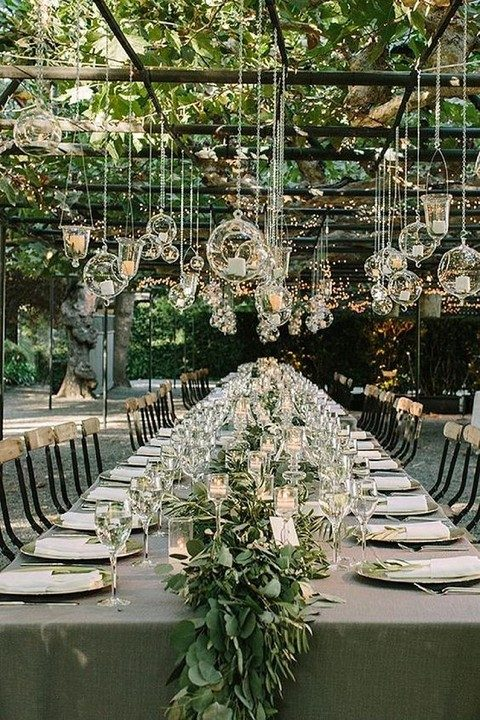 lights and glass candle holders over the reception
