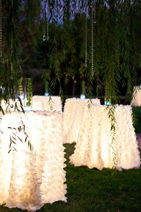 lit up tables at the wedding reception is a unique and beautiful idea