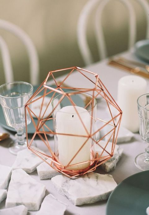 marble pieces and copper geometric candle holders
