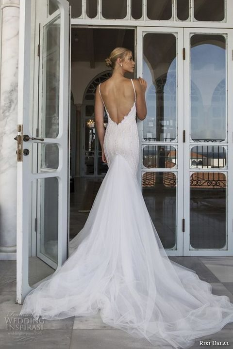 mermaid beaded wedding dress with a flowy tulle skirt and a train