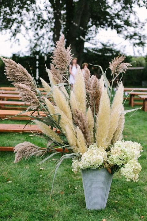metal bucket with pampas and flowers for the aisle decor