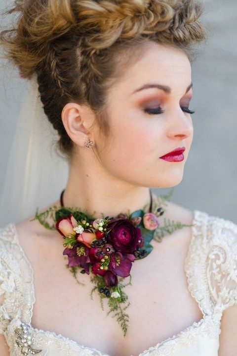 moody dark flower necklace that matches the makeup