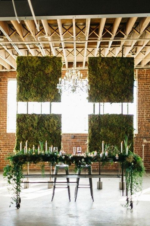 moss wall backdrop and moss and greenery on the sweetheart table
