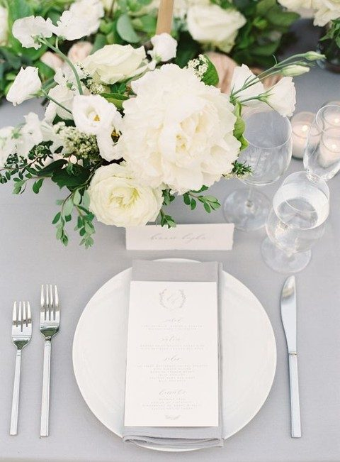 neutral florals for reception decor and lots of greenery