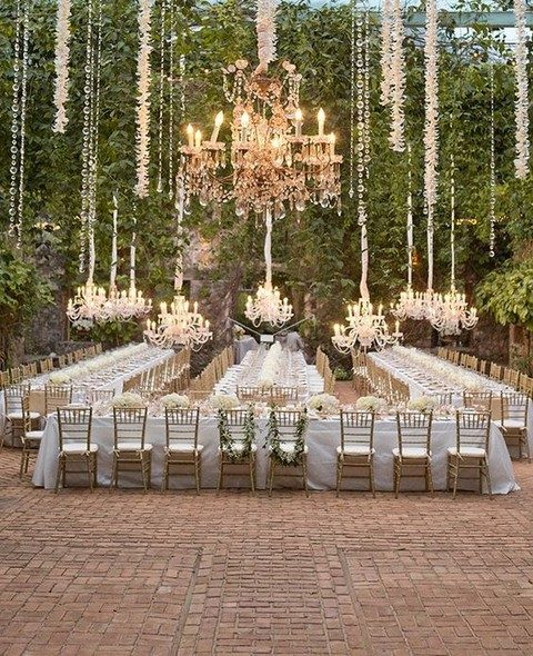 oversized refined chandeliers with crystal hangings that reflect the lights