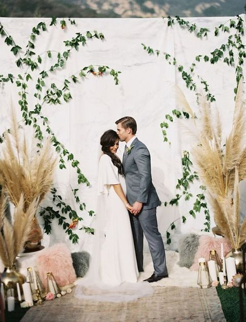 pampas grass, foliage and candle lanterns for the ceremony spot