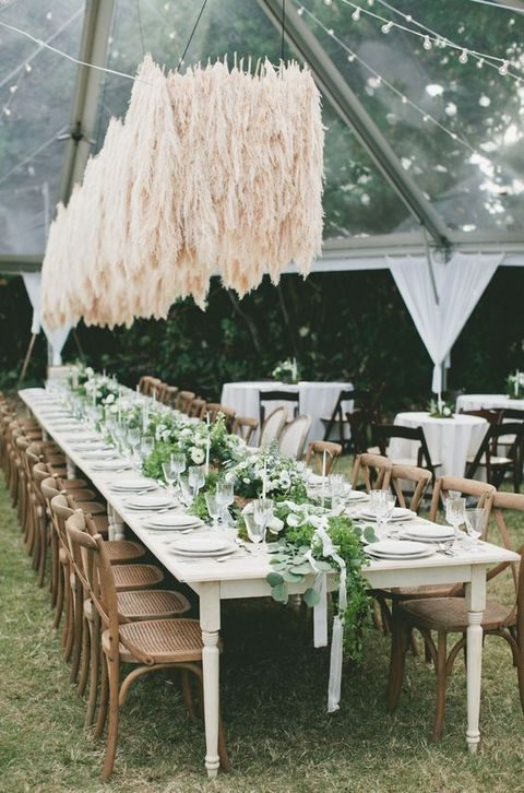 pampas grass hanging over the reception is unique decor