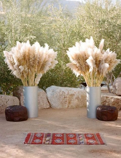 pampas grass in metal urns for the wedding ceremony spot