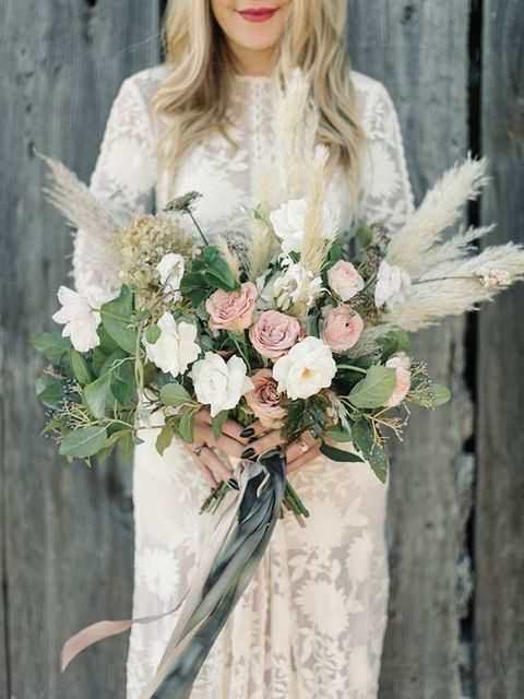 pampas grass incorporated into a neutral romantic bridal bouquet