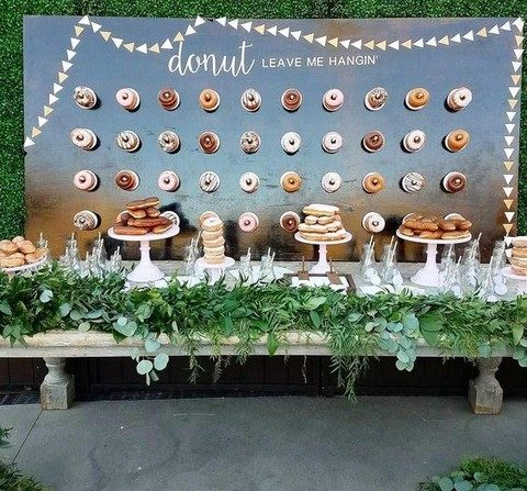 a donut bar with a wall and just donuts on stands