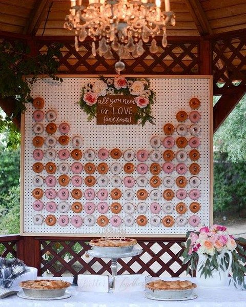 a framed pegboard wall with greenery and flower decor