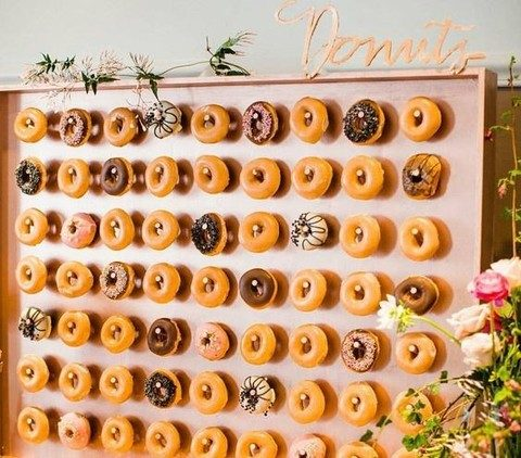 a framed pink donut wall with calligraphy