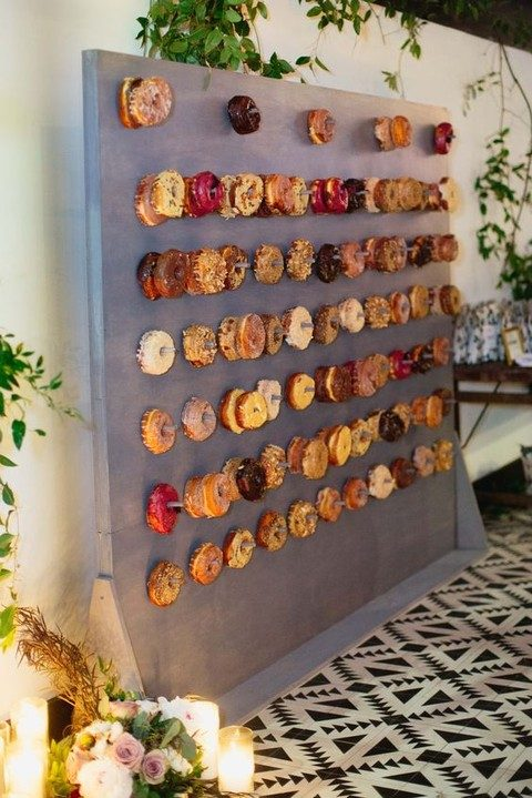 a large wall with lots of glazed donuts on hooks