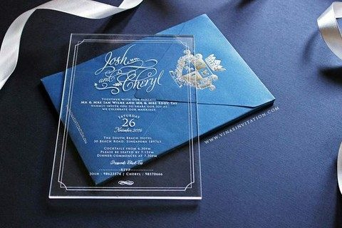 A Simple And Elegant Acrylic Wedding Invitation And A Blue Envelope