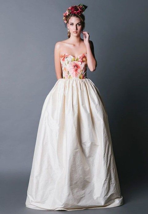 a strapless wedding dress with a floral bodice and a plain skirt