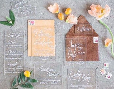 acryl wedding invites with white calligraphy and colorful envelopes