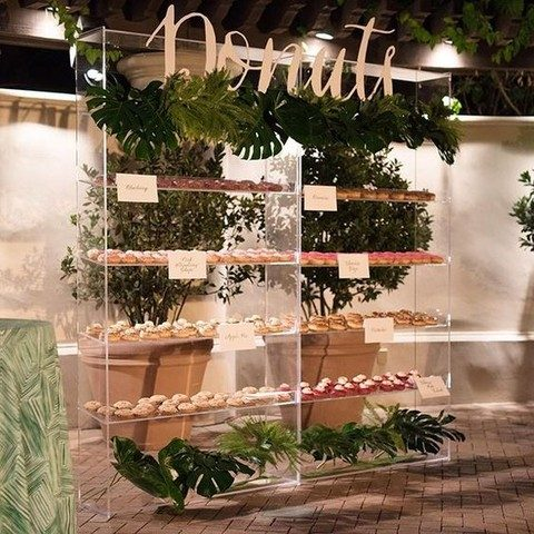 acrylic donut display decorated with greenery
