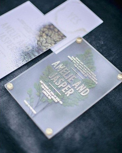acrylic invites with gold touches and pressed leaves