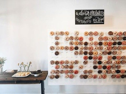 almost a sheer pegboard wall with glazed donuts