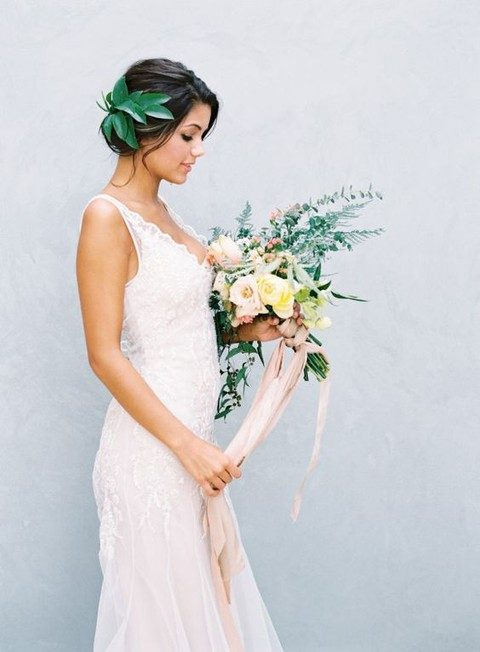 an updo topped with tropical leaves